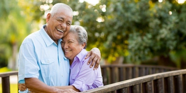 Smiling couple with dentures from their Palmdale CA dentist