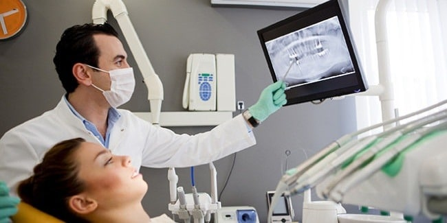 Photo of Palmdale CA dentist using dental technology