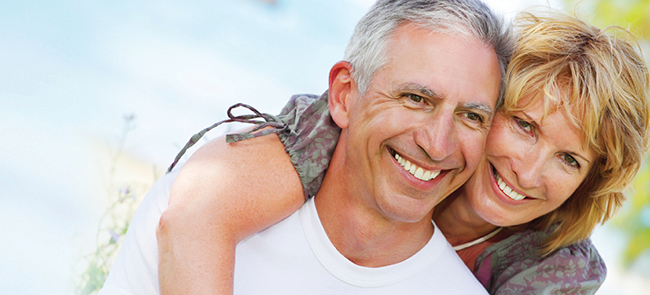 Couple after dental crowns from their Palmdale CA dentist