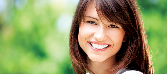 Beautiful Woman Smiling after cosmetic dentistry services from her Palmdale CA dentist