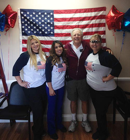 AV Sierra Dental Center team with patient during Freedom Day charity event