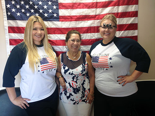 Palmdale dental team with patient after she received free dental care from AV Sierra Dental Center in honor of Freedom Day