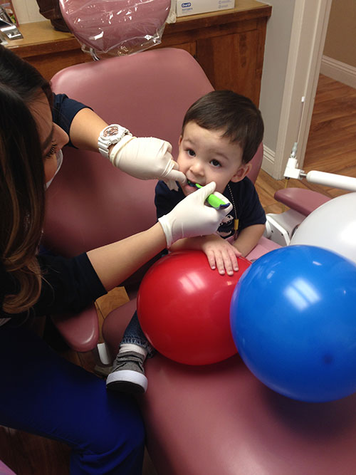 Young boy gets free dental services during AV Sierra Dental Center's Freedom Day event